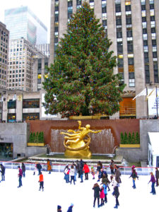NEW YORK - December 3: Skaters having fun at Rockefeller Center Ice Skating at Christmas with the famous Christmas tree on December 3rd, 2010 in New York City, USA